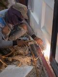 Welder working a welding metal. Not wearing glove Stock Photography