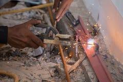 Welder working a welding metal. Not wearing glove Stock Image