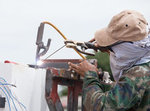 Welder working a welding metal. Royalty Free Stock Photography