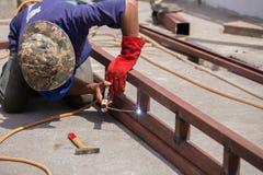 Welder working a welding metal. Not wearing glove Stock Photo