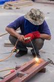 Welder working a welding metal. Not wearing glove Royalty Free Stock Photos
