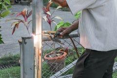 Welder working a welding metal. Not wearing the glove Royalty Free Stock Photos