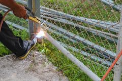 Welder working a welding metal. Not wearing the glove Stock Photography