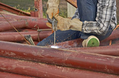 Welder works in construction site Royalty Free Stock Image