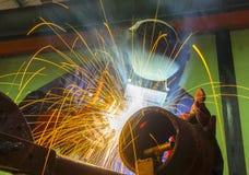 Welder at workshop. Welder in action at workshop Stock Photo