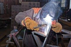 Welder in workshop conditions sample weld from sheet metal to un Stock Images