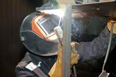 Welder in workshop conditions sample weld from sheet metal to un Stock Image
