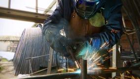 Welder in the workshop performs arc welding stock video footage