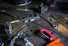 Welder workshop table.Trammel callipers tool and ruler Stock Photo