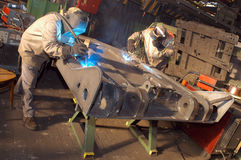 Welders. In factory stock photos