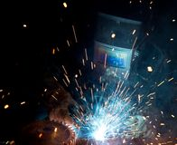 Welders in action Stock Photo