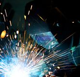 Welders in action Stock Images