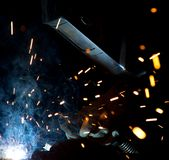 Welders in action with bright sparks. Construction and manufacturing theme Royalty Free Stock Photo
