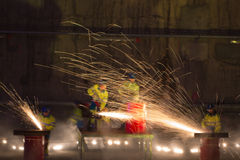 Welders in action with bright sparks Stock Photos