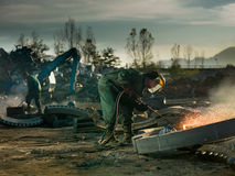 Welders cutting metal for recycling Royalty Free Stock Photo