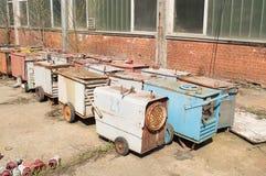 Welders. Defective welding machines left in fields Royalty Free Stock Photo