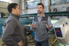 2 welders discussing in workshop Royalty Free Stock Images