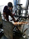 Welders. Are making fitness equipment in a workshop in the city of Solo, Central Java, Indonesia Stock Photo