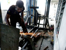 Welders. Are making fitness equipment in a workshop in the city of Solo, Central Java, Indonesia Royalty Free Stock Photos