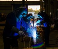 Welders with protective mask Stock Photos