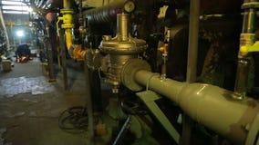 Welders repair gas boiler at a thermal power plant