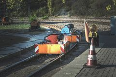 Welders in special suits and oxygen masks perform welding work o. N the tram tracks royalty free stock photo