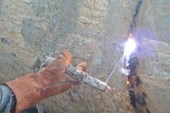 Welders welded bore pile metal casing Royalty Free Stock Image