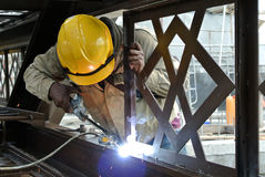 Welders welded the decorative mild steel at the construction site Stock Image
