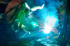 Welders in the welded steel structure. Welding steel structure in factory Royalty Free Stock Photos