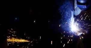 Welders welding a metal stock footage