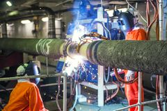 Welders welding pipes. Pipelayer at sea Stock Photos
