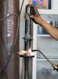 Welders were repairing Shock absorbers. Welders were repairing cutting Shock absorbers of a car in workshop Stock Image