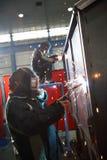 2 Welders at work. Heavy industry welder in action - stock photo Royalty Free Stock Image