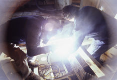 Welders at work on ship. Welders at work on the hull of a ship Stock Image