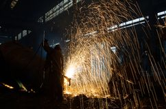 Welders at work. Welder working in a steel factory.The welding of the metal form spectacular trails of light Stock Photos
