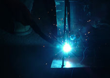 Welding. Sparks and blue light of welding a frame Royalty Free Stock Images