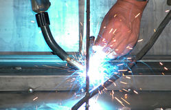Welding. Welder at work with sparks and blue light Stock Photo