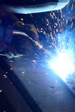 Welding. Person welding metal with blue flames Stock Image