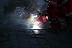 Welding. Men welding in the dark Royalty Free Stock Images