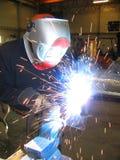 Welding. Worker welding steel in a mechanical workshop Stock Photography