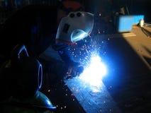 Welding. Worker welding steel in a mechanical workshop Royalty Free Stock Photos