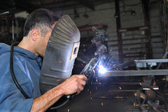 Welding. A young welder in the work Royalty Free Stock Photo