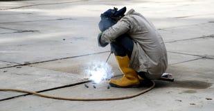 Welding. A construction worker is welding the floor plate Stock Images