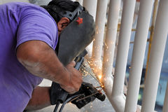 Welding. A construction welding worker, doing his job with a steel structure Royalty Free Stock Photo