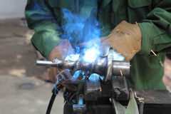 Welding. Closeup photo of arc welding of a steel shaft with helicoid Royalty Free Stock Photos
