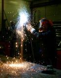 Welding. Worker in a wrokshop welding steel Stock Photo