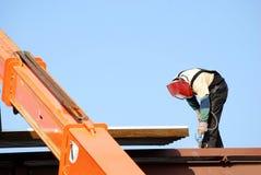 Welding. Construction worker welding a beam Stock Photo