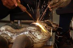 Welding. Welder repairing exhaust pipe of a car Stock Image