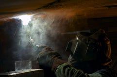 Welding. Smokey welding scene royalty free stock image