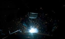 Welding. Worker welding steel in a workshop Stock Photos